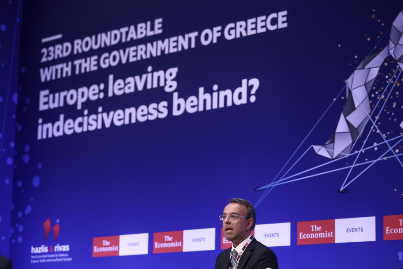 Christos Staikouras, Greece's Finance Minister, speaks at a financial conference in Lagonisi, south of Athens on Tuesday, July 16, 2019. Authorities in Greece say the country is planning tap financial markets with the issue of a 7-year bond, the first under the new conservative government of Prime Minister Kyriakos Mistotakis. (AP Photo/Yorgos Karahalis)