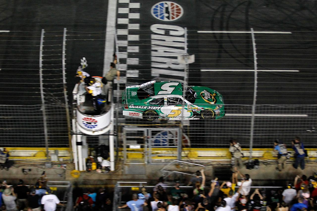 CONCORD, NC - MAY 27:  Kasey Kahne, driver of the #5 Quaker State Chevrolet, takes the checkered flag as he crosses the finish line to win the NASCAR Sprint Cup Series Coca-Cola 600 at Charlotte Motor Speedway on May 27, 2012 in Concord, North Carolina.  (Photo by Streeter Lecka/Getty Images)