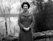 <p>The Queen stands in the gardens of Buckingham Palace to record her 1975 Christmas broadcast. This was the first time she had made her address outdoors. (PA Archive) </p>
