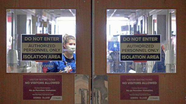 PHOTO: Doors to a COVID-19 treatment unit at UW Health in Madison, Wis. caution hospital personnel and visitors, Nov. 5, 2020. (John Hart/AP, FILE)