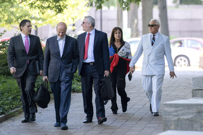 Roger Stone, right, a longtime confidant of President Donald Trump, accompanied by his wife, Nydia Stone, and lawyers, arrives at federal court in Washington, Tuesday, July 16, 2019. (AP Photo/Sait Serkan Gurbuz)