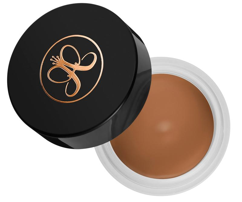 "<p>Since the skin around the eye area tends to run on the drier side, many full coverage concealers tend to stick and settle into fine lines and accentuate them. However, this creamy formula glides on easily to cover shadows without ever getting cakey.</p> <p>$20 | <a rel=""nofollow"" href='http://click.linksynergy.com/fs-bin/click?id=93xLBvPhAeE&subid=0&offerid=429865.1&type=10&tmpid=719&RD_PARM1=http%253A%252F%252Fwww.sephora.com%252Fconcealer-P406282%253FskuId%253D1792134%2526icid2%253Danastasia_contour_carousel%253Ap406282&u1=ISELunderey'>SHOP IT</a></p>"