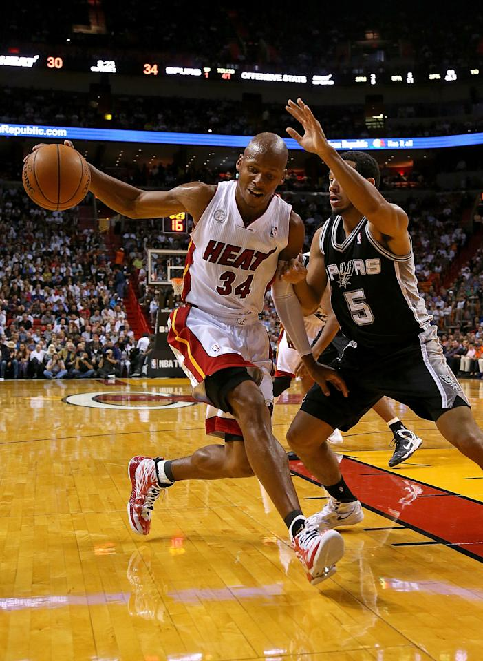 MIAMI, FL - NOVEMBER 29:  Ray Allen #34 of the Miami Heat drives on Cory Joseph #5 of the San Antonio Spurs during a game  at American Airlines Arena on November 29, 2012 in Miami, Florida.  (Photo by Mike Ehrmann/Getty Images)