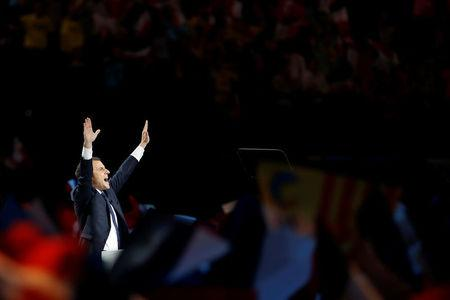 Emmanuel Macron, head of the political movement En Marche !, or Onwards !, and candidate for the 2017 French presidential election, delivers a speech during a campaign political rally at the AccorHotels Arena in Paris, France, April 17, 2017. REUTERS/Benoit Tessier