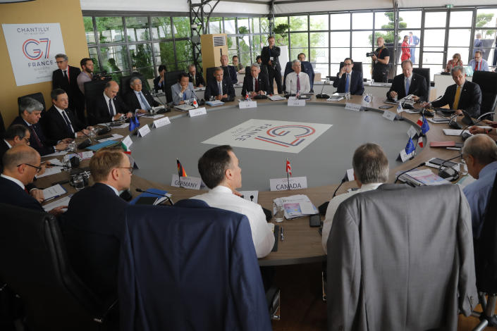 Finance ministers and banks governors attend a session at the G-7 Finance Wednesday July 17, 2019 in Chantilly, north of Paris. The Trump administration is objecting to France's plan to tax Facebook, Google and other U.S. tech giants, a rift that's overshadowing talks between seven longtime allies near Paris this week on issues ranging from digital currencies to trade. (AP Photo/Michel Euler)