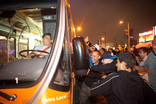 LOS ANGELES, CA - JUNE 11: A group of fans attack a city bus after the Los Angeles Kings defeated the New Jersey Devils to win the 2012 Stanley Cup Final June 11, 2012 in Los Angeles, California. The win is the Los Angeles Kings first championship in franchise history. (Photo by Jonathan Gibby/Getty Images)