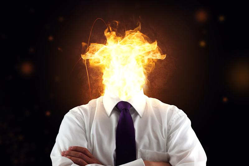 Business man with burnout syndrome and burning head. Source: Getty