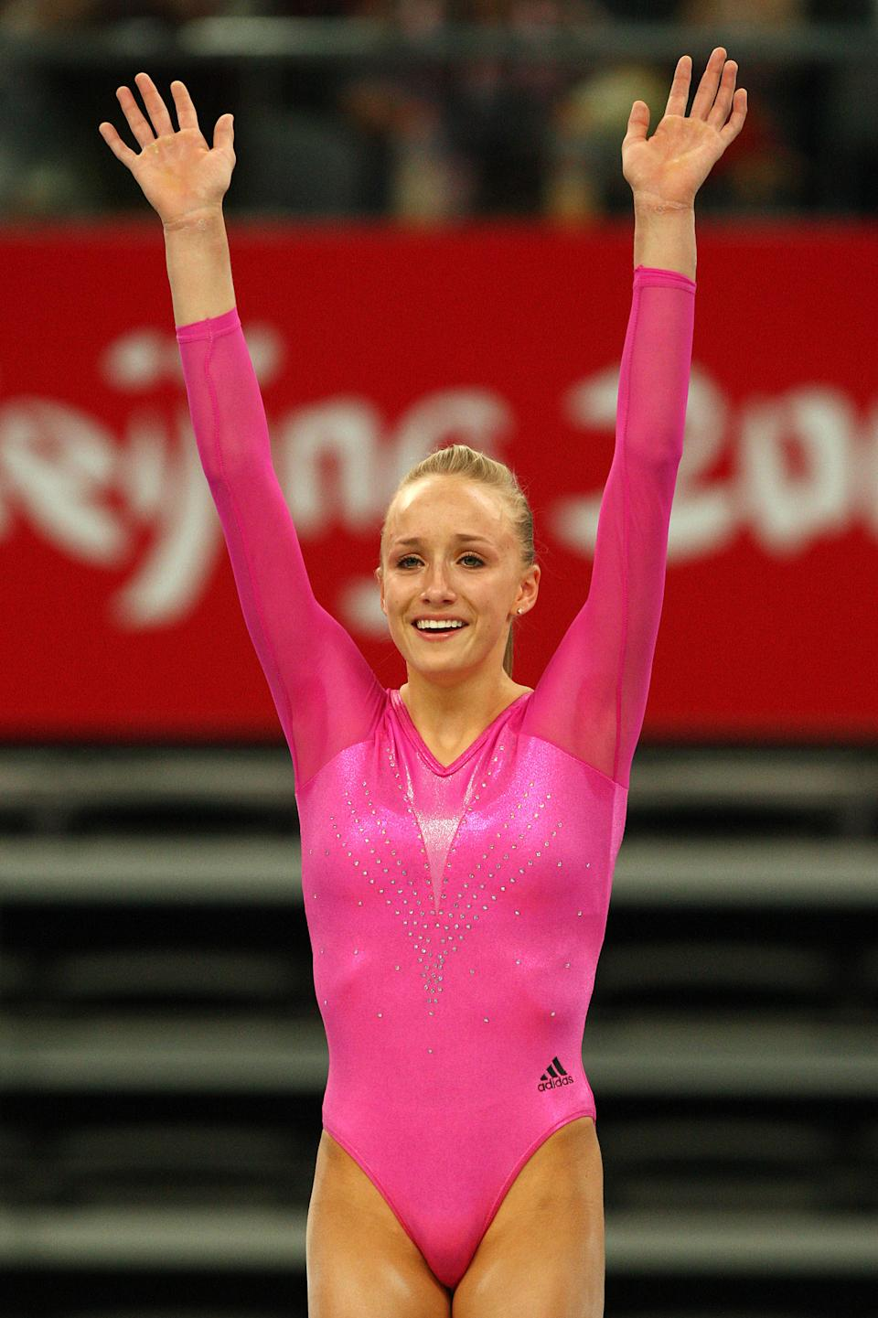 BEIJING - AUGUST 15: Nastia Liukin of the United States waves to the crowd after winning the gold medal in the women's individual all-around artistic gymnastics final at the National Indoor Stadium on Day 7 of the Beijing 2008 Olympic Games on August 15, 2008 in Beijing, China. (Photo by Quinn Rooney/Getty Images)