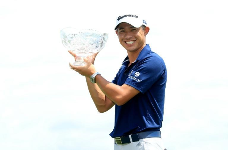 American Collin Morikawa celebrates with the winner's trophy after the final round of the Workday Charity Open at Muirfield Village Golf Club