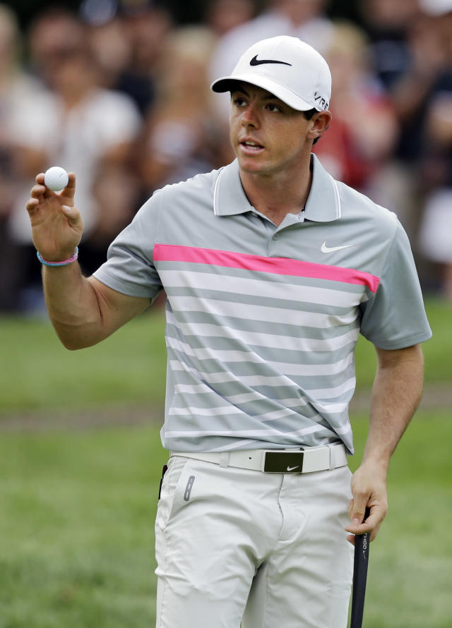 Rory McIlroy celebrates a birdie on the third hole during the final round of the Bridgestone Invitational golf tournament Sunday, Aug. 3, 2014, at Firestone Country Club in Akron, Ohio. (AP Photo/Mark Duncan)