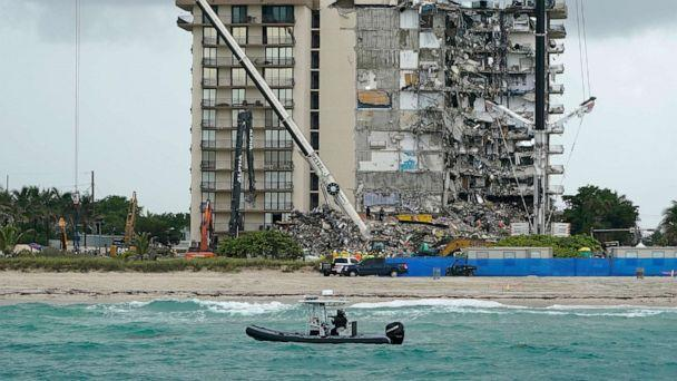 PHOTO: A Florida Fish and Wildlife Conservation law enforcement boat patrols the oceanfront as search and rescue efforts continue at the Champlain Towers South condo building, June 30, 2021, in Surfside, Fla., near Miami Beach. (Lynne Sladky/AP)