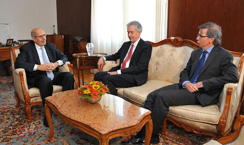 This image released by the Egyptian Presidency shows interim Vice President Mohamed Elbaradei, left, meets with U.S. Deputy Secretary of State William Burns, center, in Cairo, Egypt, Tuesday, Aug. 6, 2013. Top U.S., European and Arab envoys visited a jailed Muslim Brotherhood leader Monday on a mission to ease tensions between Egypt's military-backed government and supporters of ousted Islamist President Mohamed Morsi. The talks between Burns and Khairat el-Shater took place in the prison where the Muslim Brotherhood figure is being held.(AP Photo/Egyptian Presidency)