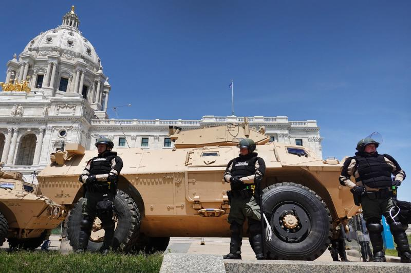 Police in St. Paul, Minn. stand guard at the state capital building on on May 31, 2020 during a protest as unrest continues in the city and around the U.S. following the May 25 death of George Floyd.