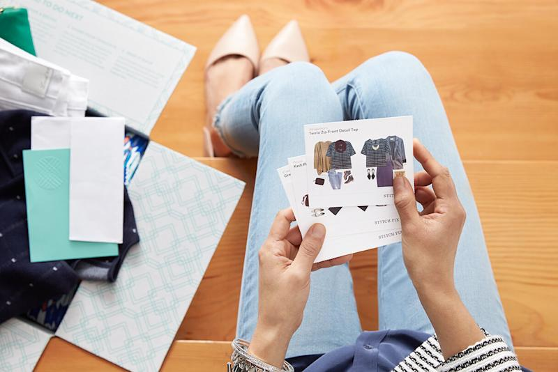 Woman looking at Stitch Fix style cards