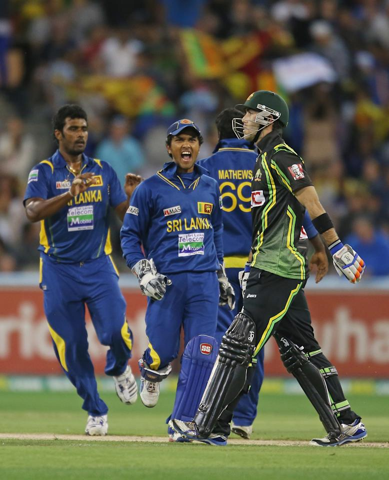 MELBOURNE, AUSTRALIA - JANUARY 28:  Dinesh Chandimal of Sri Lanka celebrates as Glenn Maxwell (R) of Australia walks from the field after the final ball of the game during game two of the Twenty20 International series between Australia and Sri Lanka at the Melbourne Cricket Ground on January 28, 2013 in Melbourne, Australia.  (Photo by Scott Barbour/Getty Images)