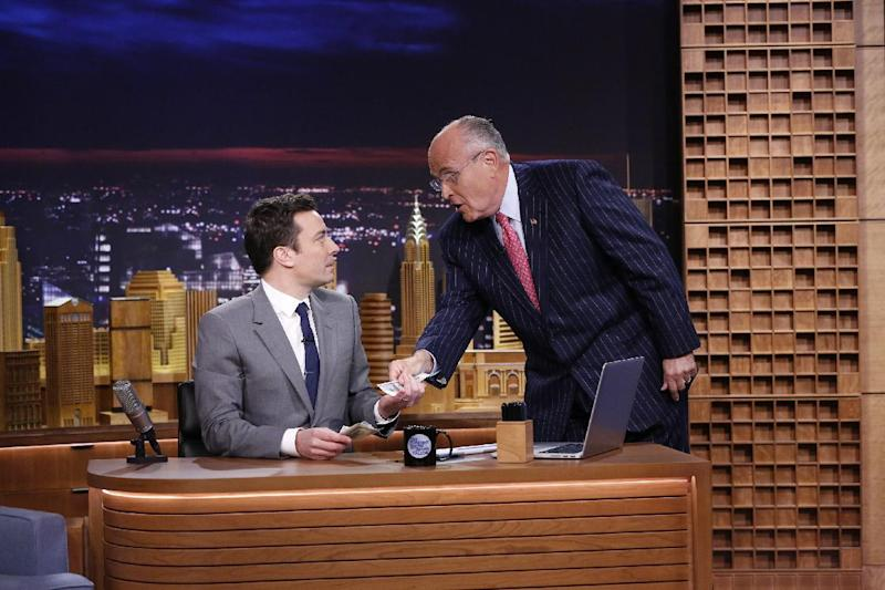 "In this photo provided by NBC, Jimmy Fallon appears with former New York City Mayor Rudy Giuliani, right, during his ""The Tonight Show"" debut on Monday, Feb. 17, 2014, in New York. Fallon departed from the network's ""Late Night"" on Feb. 7, 2014, after five years as host, and is now the host of ""The Tonight Show,"" replacing Jay Leno after 22 years. (AP Photo/NBC, Lloyd Bishop)"
