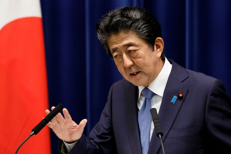 FILE PHOTO: Japanese PM Abe gives news conference in Tokyo
