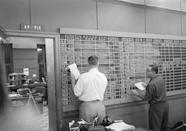 Associated Press Washington, D.C., staffers, Frank Vaille, left, and Gordon Brown keep up to date on the Governor's tabulation board on election night, Nov. 4, 1958. (AP Photo)