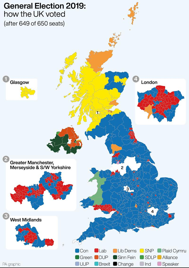 The UK has turned blue and yellow. (PA)