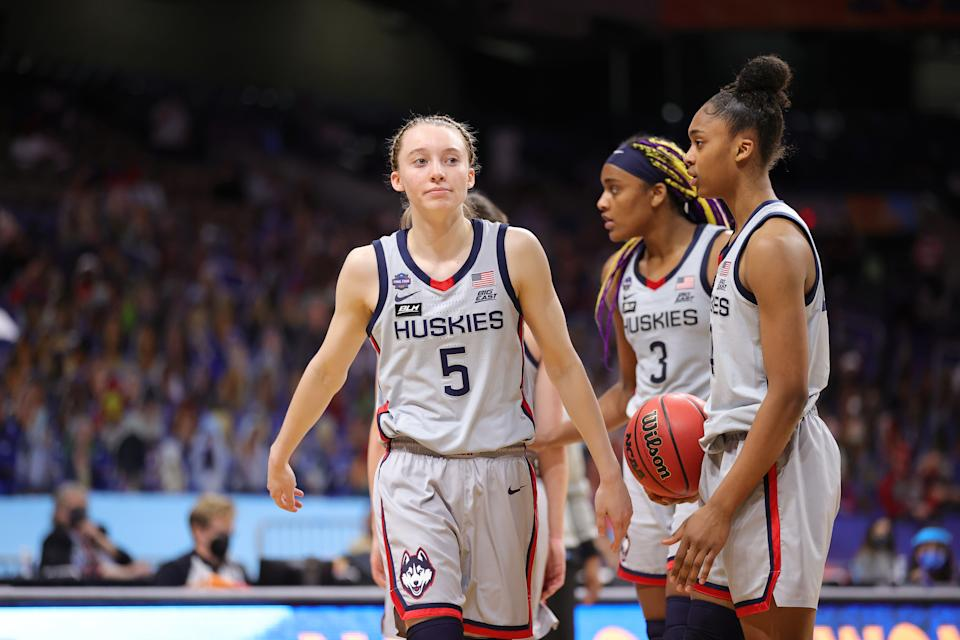 UConn's Paige Bueckers (left) reacts during her team's loss to the Arizona Wildcats in the Final Four of the 2021 NCAA women's basketball tournament on April 02. (Carmen Mandato/Getty Images)