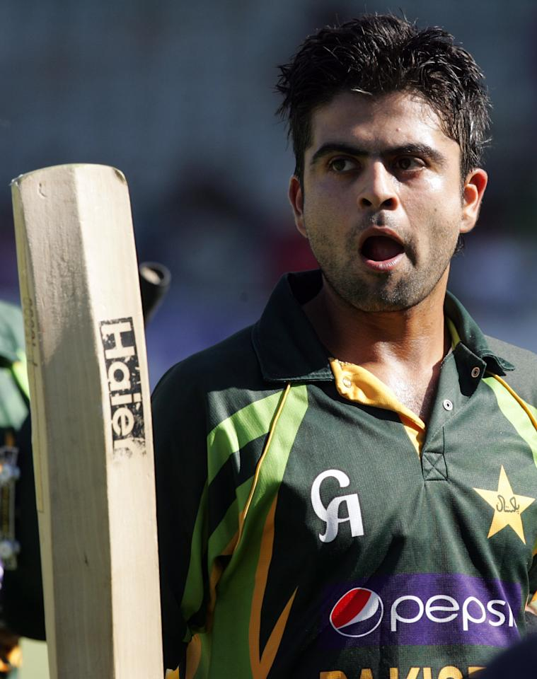 Pakistan's batsman Ahmed Shehzad salutes the crowd on reaching his 98 during the second and final Twenty20 international between Zimbabwe and Pakistan at the Harare Sports Club on August 24, 2013.   AFP PHOTO / JEKESAI NJIKIZANA        (Photo credit should read JEKESAI NJIKIZANA/AFP/Getty Images)