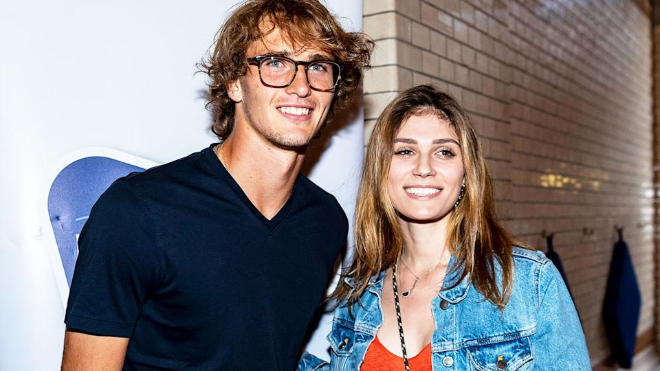 Alexander Zverev (pictured left) and his former-girlfriend Olga Sharypova (pictured right) pose for a photo.