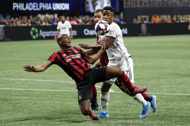 Philadelphia Union forward Sergio Santos, right, and Atlanta United midfielder Darlington Nagbe compete for the ball in front of the net during the first half of an MLS soccer Eastern Conference semifinal Thursday, Oct. 24, 2019, in Atlanta. (AP Photo/John Bazemore)