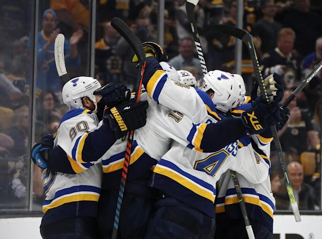 Zach Sanford #12 of the St. Louis Blues is congratulated by his teammates after scoring a third period goal against the the Boston Bruins reacts in Game Seven of the 2019 NHL Stanley Cup Final at TD Garden on June 12, 2019 in Boston, Massachusetts. (Photo by Bruce Bennett/Getty Images)