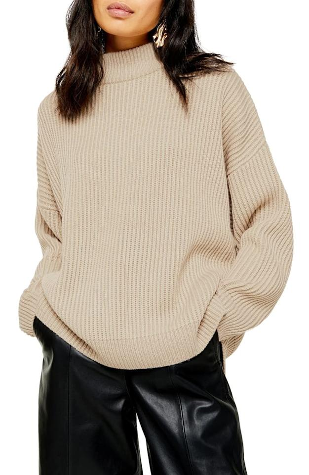 """<p>This <a href=""""https://www.popsugar.com/buy/Topshop-Mock-Neck-Sweater-491274?p_name=Topshop%20Mock%20Neck%20Sweater&retailer=shop.nordstrom.com&pid=491274&price=75&evar1=fab%3Aus&evar9=43950050&evar98=https%3A%2F%2Fwww.popsugar.com%2Ffashion%2Fphoto-gallery%2F43950050%2Fimage%2F46639518%2FTopshop-Mock-Neck-Sweater&list1=shopping%2Cfall%20fashion%2Csweaters%2Cfall&prop13=api&pdata=1"""" rel=""""nofollow"""" data-shoppable-link=""""1"""" target=""""_blank"""" class=""""ga-track"""" data-ga-category=""""Related"""" data-ga-label=""""https://shop.nordstrom.com/s/topshop-mock-neck-sweater/5399655?origin=category-personalizedsort&amp;breadcrumb=Home%2FWomen%2FClothing%2FSweaters&amp;fashioncolor=White&amp;color=oat"""" data-ga-action=""""In-Line Links"""">Topshop Mock Neck Sweater </a> ($75) is so cuddly.</p>"""
