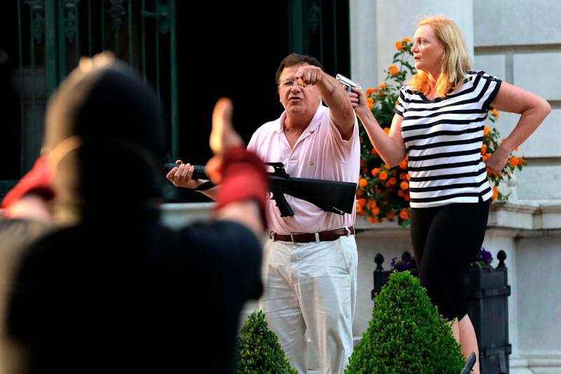 The armed homeowners pointed guns at protesters marching to Mayor Lyda Krewson's house: AP