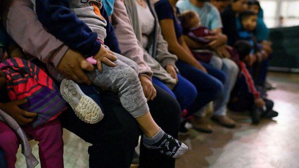 PHOTO: Recently detained migrants, many of them family units, sit and await processing in the US Border Patrol Central Processing Center in McAllen, Texas on August 12, 2019. (Carolyn Van Houten/The Washington Post via Getty Images)