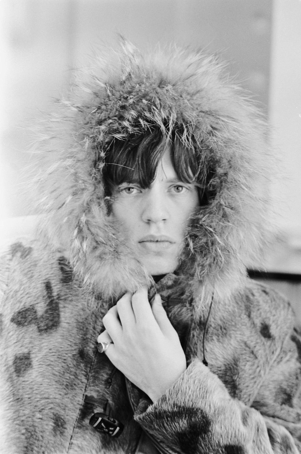 Mick Jagger, lead singer of the Rolling Stones, wearing a fur-lined parka, 1965. (Photo by Terry O'Neill/Hulton Archive/Getty Images)