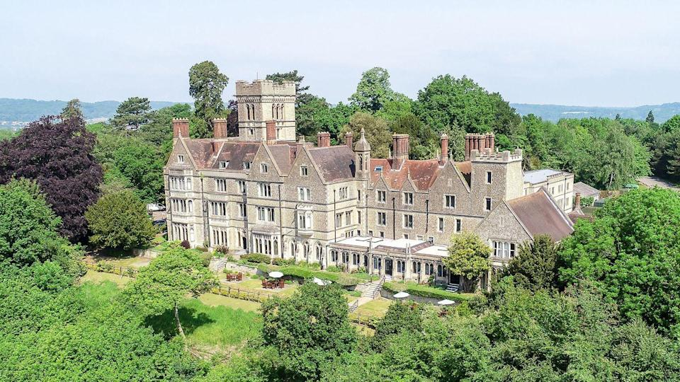 """<p>This unique Victorian mansion is inspired by the Neo-Gothic splendour of the Palace of Westminster. Dating back to 1872, beautiful original features pepper the hotel, with stone carvings, fine artwork, grand marble fireplaces and an organ restored by the Shepherd Brothers of London. </p><p>The hotel has 60 bedrooms including 15 feature bedrooms and, for that little extra indulgence, The Byron Suite located in the tower is spread over three floors. A grand country house getaway with minimum travel time this is one of the finest hotels outside London.</p><p><strong>Distance from London by train:</strong> 30 minutes.</p><p><a class=""""link rapid-noclick-resp"""" href=""""https://go.redirectingat.com?id=127X1599956&url=https%3A%2F%2Fwww.booking.com%2Fhotel%2Fgb%2Fnutfield-priory.en-gb.html%3Faid%3D2070929%26label%3Dhotels-outside-london&sref=https%3A%2F%2Fwww.redonline.co.uk%2Ftravel%2Finspiration%2Fg34469437%2Fhotels-outside-london%2F"""" rel=""""nofollow noopener"""" target=""""_blank"""" data-ylk=""""slk:CHECK AVAILABILITY"""">CHECK AVAILABILITY</a></p><p><strong>Sign up for inspirational travel stories and to hear about our favourite financially protected escapes and bucket list adventures.</strong></p><p><a class=""""link rapid-noclick-resp"""" href=""""https://hearst.emsecure.net/optiext/optiextension.dll?ID=y_jyzVjkVOLriSE7FGQSZGKd2N3MLYoM_Oq8NR9MT8hFZnl8ZsrCUG075elObNgTkQgWpkPrG59Ryx"""" rel=""""nofollow noopener"""" target=""""_blank"""" data-ylk=""""slk:SIGN UP"""">SIGN UP</a></p>"""