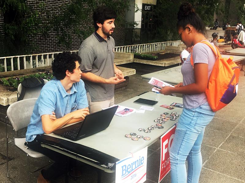 Jonathan Bo-o (left) and Matthew Golden (center) talk to a fellow student at Georgia State University about Fort's mayoral bid.