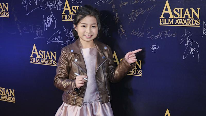Celine Tam steals the show on Asian Film Awards red carpet in Macau
