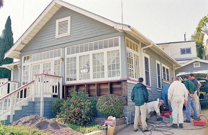 Members of the  San Luis Obispo County Sheriff's Department and FBI searched the grounds of Susan Flores's home in Arroyo Grande on June 19, 2000, for any evidence that might shed light on the disappearance of Cal Poly student Kristin Smart.  / Credit: David Middlecamp/The Tribune_Zuma Press
