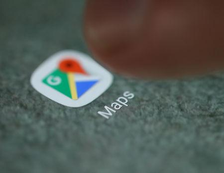 The Google Maps app logo is seen on a smartphone in this illustration