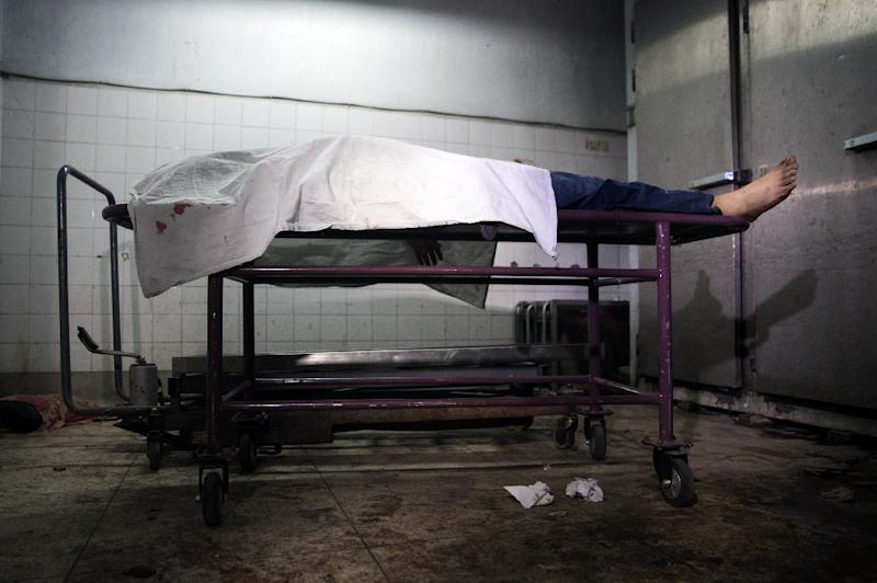 The body of Avijit Roy, a US blogger of Bangladeshi origin who was hacked to death, pictured on February 27, 2015 at the Dhaka Medical Collage hospital morgue (AFP Photo/Rajib Dhar)