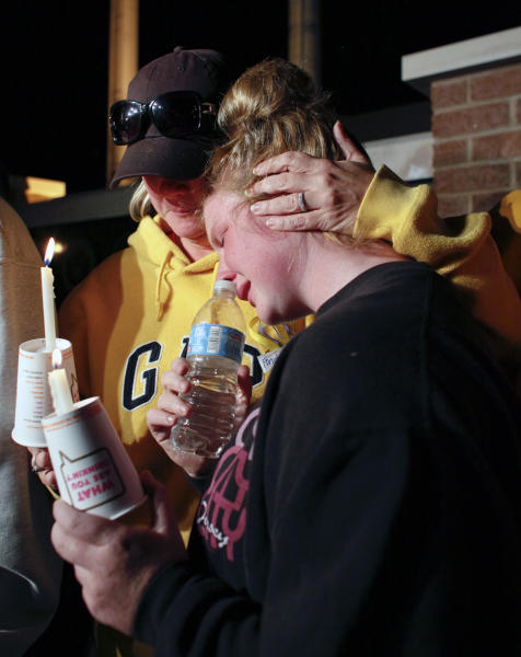 Jennifer Cornwell, mother of the missing girl Autumn Pasquale, comforts her other daughter Natalie Pasquale, 11, during a candlelight vigil, Monday Oct. 22, 2012, in Clayton, N.J. About 200 law enforcement officials and hundreds more volunteers searched Monday for a southern New Jersey girl who disappeared over the weekend, raising anxiety in a rural town and pulling residents together. (AP Photo/Joseph Kaczmarek)
