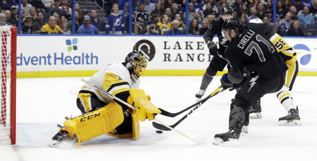 Tampa Bay Lightning center Anthony Cirelli (71) beats Pittsburgh Penguins goaltender Casey DeSmith (1) for a goal during the second period of an NHL hockey game Saturday, Feb. 9, 2019, in Tampa, Fla. (AP Photo/Chris O'Meara)