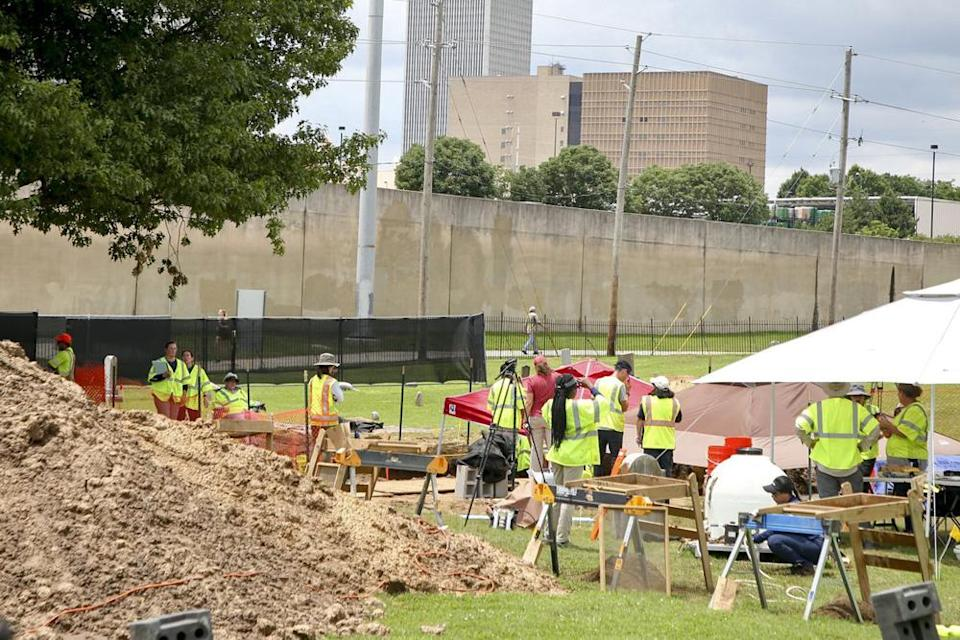 Workers excavating remains of possible Tulsa Race Massacre victims at Oaklawn Cemetery on Tuesday (local time). Source: AP