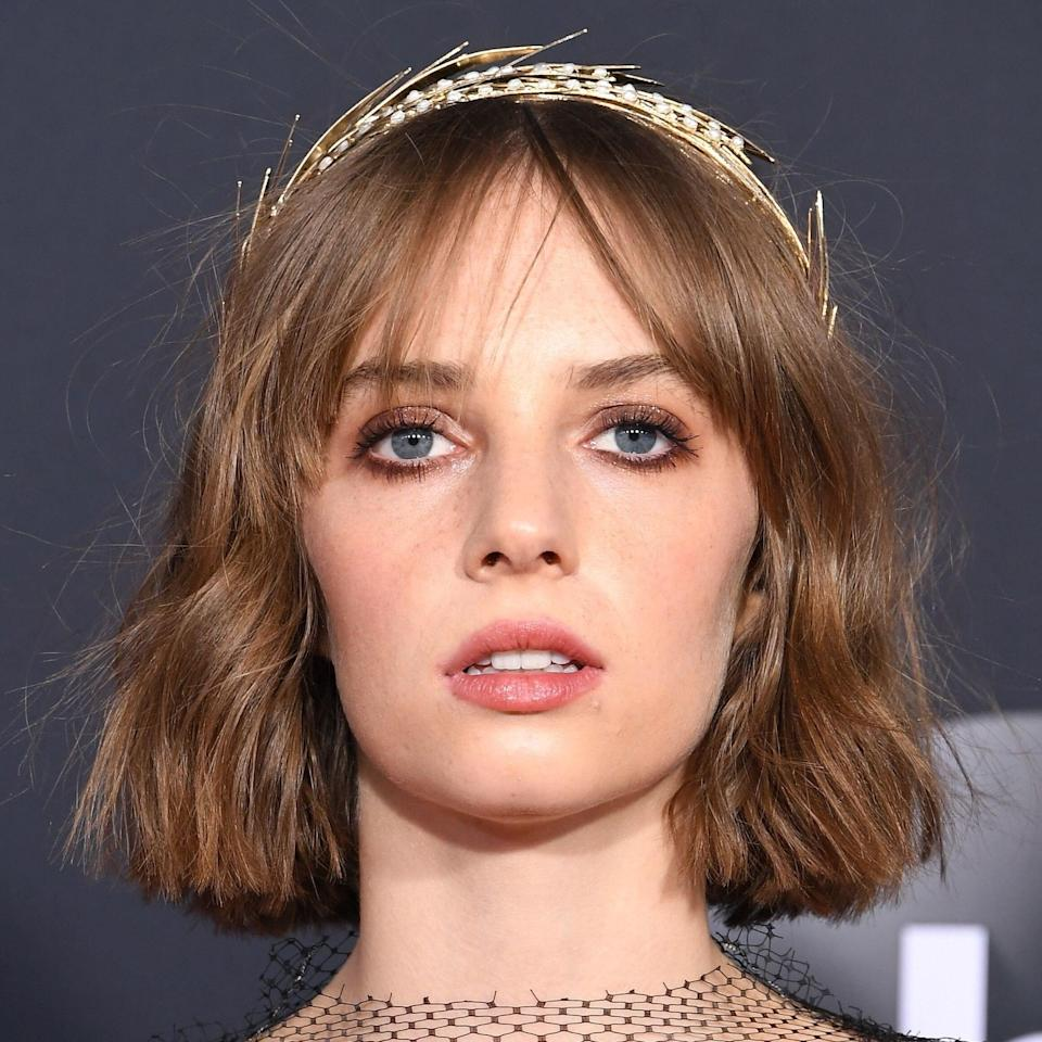 """Maya Hawke proves a flirty, choppy bob is just as fresh as a blunt one. """"Slightly uneven layers gives this a modern edge, and having your stylist use a razor will give it a feathery finish,"""" explains Matrix colorist, <a href=""""https://www.instagram.com/georgepapanikolas/?hl=en"""" rel=""""nofollow noopener"""" target=""""_blank"""" data-ylk=""""slk:George Papanikolas"""" class=""""link rapid-noclick-resp"""">George Papanikolas</a>. """"For soft separation and definition use the <a href=""""https://www.matrix.com/biolage/raw/raw-products/styling/raw-texturizing-styling-spray"""" rel=""""nofollow noopener"""" target=""""_blank"""" data-ylk=""""slk:Biolage R.A.W. Texturizing Styling Spray"""" class=""""link rapid-noclick-resp"""">Biolage R.A.W. Texturizing Styling Spray</a>. It gives volume and texture with a clean feel."""""""