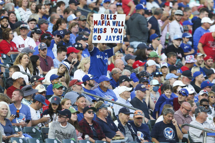 A spectator holds a sign during the third inning of a baseball game between the Toronto Blue Jays and the Boston Red Sox on Wednesday, July 21, 2021, in Buffalo, N.Y. (AP Photo/Joshua Bessex)