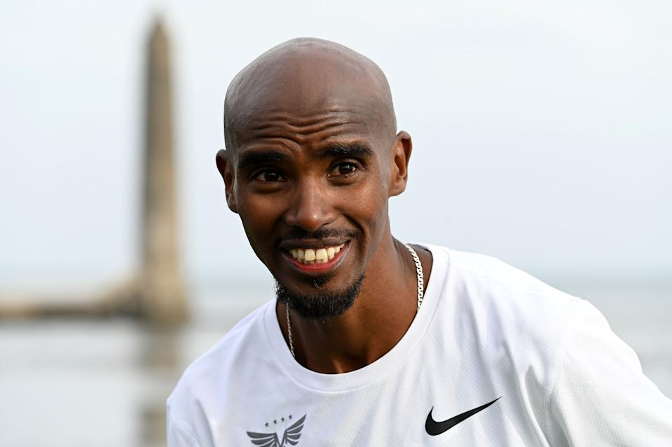 Sir Mo Farah after crossing the finish line after taking part in the Antrim Coast Half Marathon. The four-time Olympic gold medallist joined an elite line-up in Larne, County Antrim after accepting an invitation from race organiser James McIlroy.
