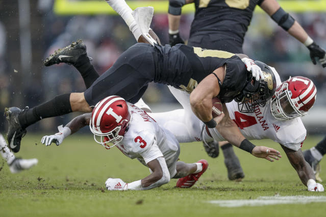 "Purdue's Zander Horvath (top) is tackled by Indiana's <a class=""link rapid-noclick-resp"" href=""/ncaaf/players/304095/"" data-ylk=""slk:Tiawan Mullen"">Tiawan Mullen</a> (L) and Cam Jones (R) in the first half at Ross-Ade Stadium on Nov. 30, 2019 in West Lafayette, Indiana. (Photo by Michael Hickey/Getty Images)"