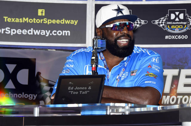 """Former Dallas Cowboy Ed """"Too Tall"""" Jones participates in a news conference before the IndyCar auto race Saturday, June 9, 2018, in Fort Worth, Texas. (AP Photo/Larry Papke)"""