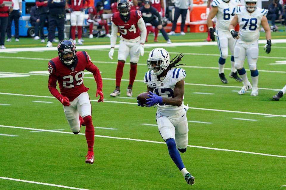 Indianapolis Colts wide receiver T.Y. Hilton (13) is perused by Houston Texans cornerback Phillip Gaines (29) after a catch during the first half of an NFL football game Sunday, Dec. 6, 2020, in Houston.