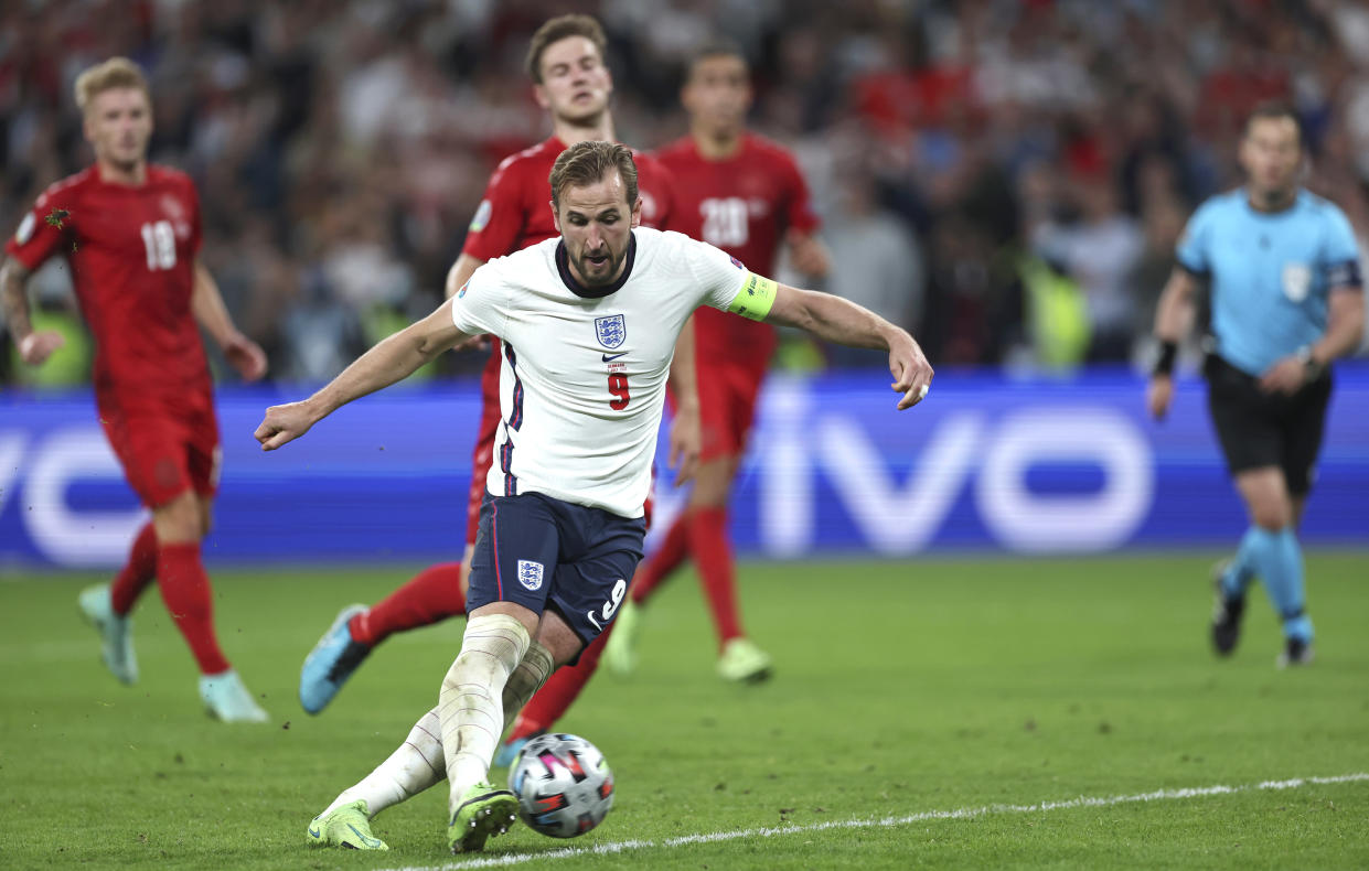 LONDON, ENGLAND - JULY 07: Harry Kane of England scores from the rebound of a missed penalty for their team's second goal during the UEFA Euro 2020 Championship Semi-final match between England and Denmark at Wembley Stadium on July 07, 2021 in London, England. (Photo by Eddie Keogh - The FA/The FA via Getty Images)