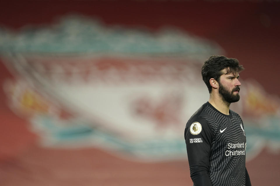 Liverpool's goalkeeper Alisson stands on the pitch during the English Premier League soccer match between Liverpool and Manchester City at Anfield Stadium, Liverpool, England, Sunday, Feb. 7, 2021. (AP photo/Jon Super, Pool)