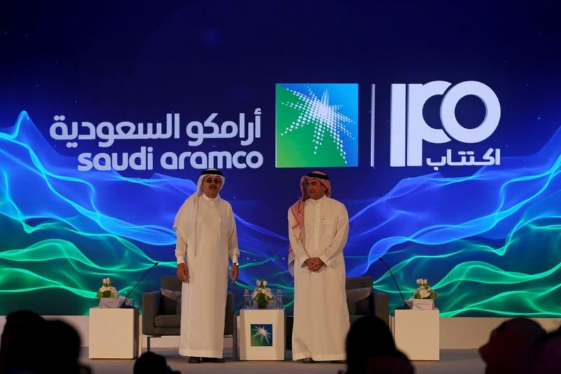 Yasser al-Rumayyan, Saudi Aramco's chairman, and Amin H. Nasser, president and CEO of Aramco, attend a news conference in Dhahran
